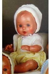 Mini Juanin Baby gelben Overall und weiße Jacke